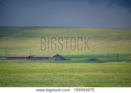 Beautiful tranquil spring rural landscape with abandoned farm and old cowshed