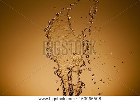 Texture of water on a gold background, similar to the liquid metal