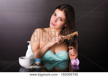 Pretty Young Woman With Cosmetics
