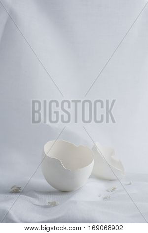 An egg shell on a vintage background.