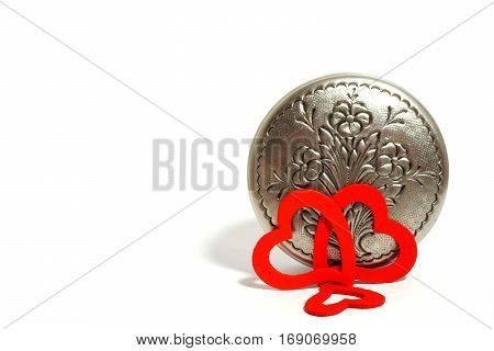 Silver metallic retro casket and hearts on white background.