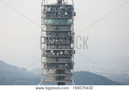Barcelona Spain - January 03 2017: The equipment of Telecoms Tower closeup in misty weather design of tower by Norman Foster architect