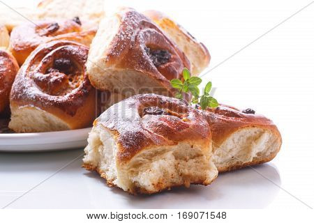 sweet rolls with raisins on the white table