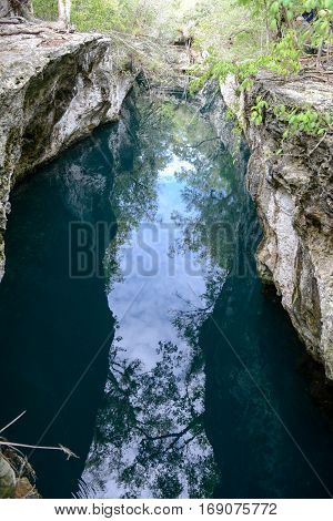 Giron Cuba - 20 january 2016: people admiring the view at the cenote on the forest at Giron on Cuba