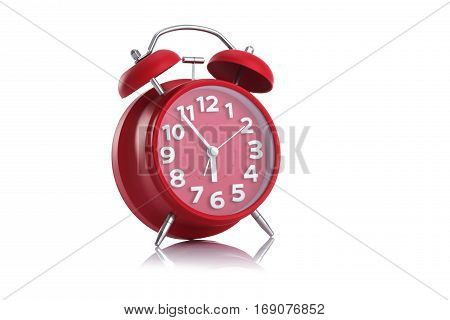 Red alarm clock isolated on white background