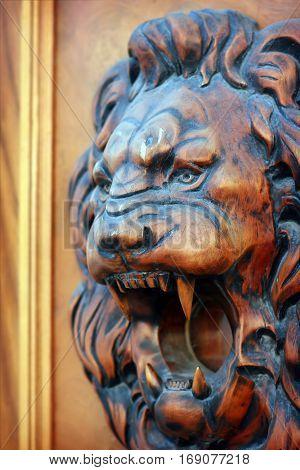 Lion wooden relief part of an old door