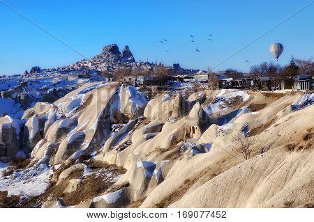 UÇHISAR CASTLE CAPPADOCIA BALLOON WINTER VIEW LANDSCAPE