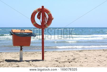 lifebuoy on the beach on sea and sky background