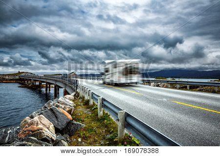 Caravan car travels on the highway. Caravan Car in motion blur. Norway. Atlantic Ocean Road or the Atlantic Road (Atlanterhavsveien) been awarded the title as