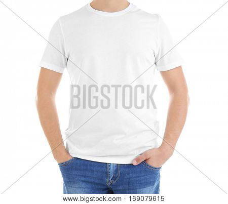 Handsome young man in blank t-shirt on white background, close up