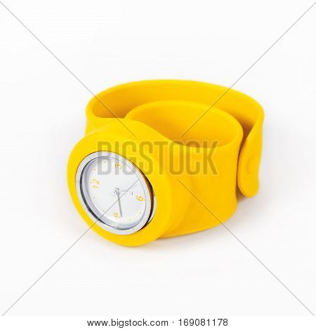 Yellow watch on a flexible yellow thong is isolated on a white background