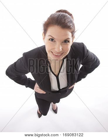 Young business woman looking up from above isolated on white background