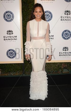 LOS ANGELES - JAN 7:  Chrissy Teigen at the Art of Elysium 10th Annual Black Tie Heaven Gala at Red Studios on January 7, 2017 in Los Angeles, CA
