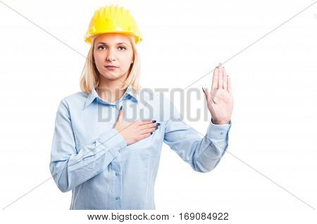 Blonde Lady Engineer Taking Oath With Hand Up