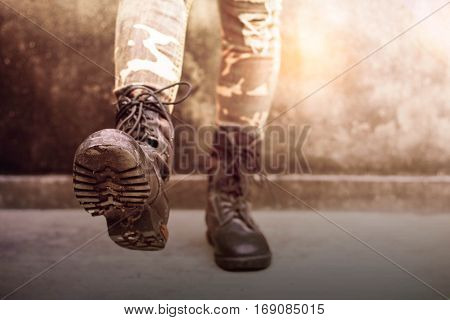 Boots of female soldiers who were practicing strumming.