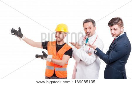 Group Of Three Handsome Men Presenting Something