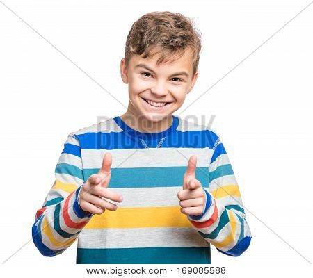 Half-length emotional portrait of caucasian teen boy. Funny teenager pointing at camera choosing you, isolated on white background. Handsome happy child pointing fingers to you.
