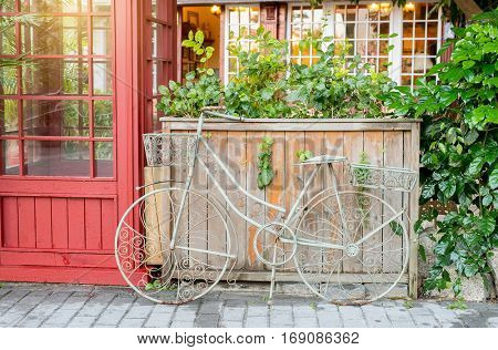 bicycle  made of metal in flower garden