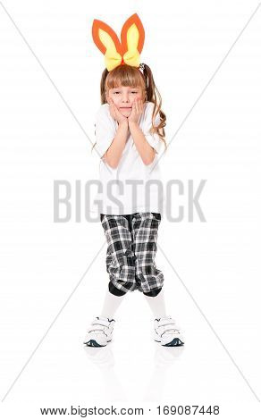 Funny little girl in white T-shirt with rabbit ears, isolated on white background