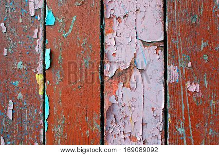 Texture wooden background of old texture wooden planks with peeling texture paint. Texture of peeling paint on the wood. Old wooden texture background surface.Rough peeling paint texture background. Wooden texture background