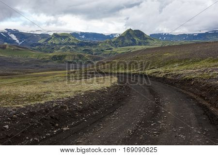 Icelandic wild outback black sand journey with green mountains along the river Markarfljot Iceland