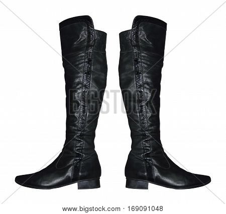 Pair of Women knee-high leathers boot isolated on white background.
