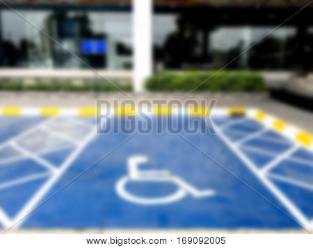 Blurred background wheel chair symbol in parking lot