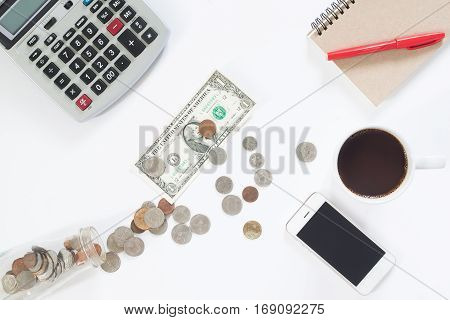 Accounting concept with calculator money coffee and mobile phone on white background