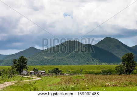 Before the storm. Farm in the Cuban province background pyramidal hills.