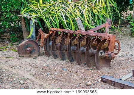 Rusty Old Disc Harrow Agricultural Tool .