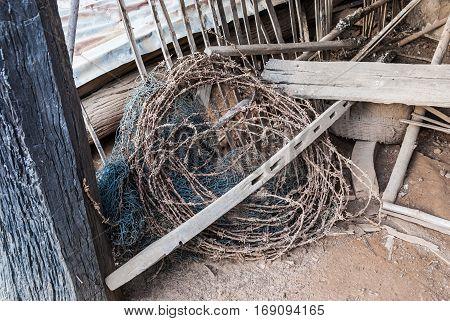 Roll of Rusty Barbed Wire and Dirty Nylon Net