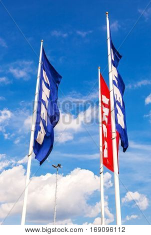 SAINT PETERSBURG RUSSIA - JULY 28 2016: IKEA flags against sky at the IKEA Store. IKEA is the world's largest furniture retailer