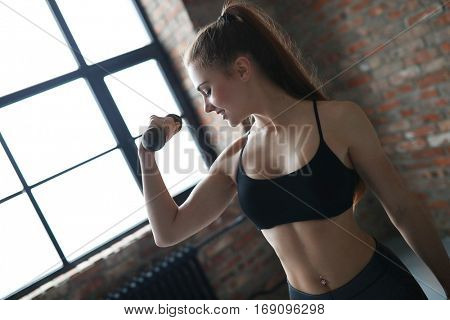 Workout, sport. Woman in the gym