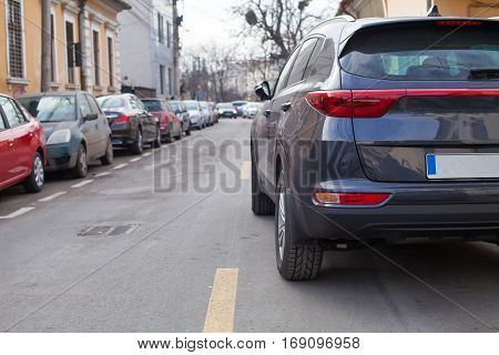 Picture of a crowded street with parking spots in Cluj Napoca's downtown