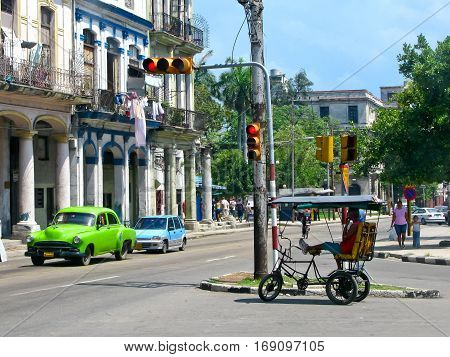 Trishaw stopped at a red traffic light in Havana. Cuba, June 5, 2009.