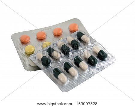 two sets of colored pills and tablets
