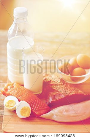 healthy lifestyle, culinary, cooking and diet concept - close up of natural protein food still life on wooden table in kitchen