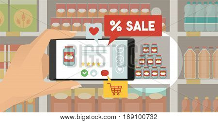 Man doing grocery shopping at the supermarket he is viewing offers and augmented reality contents on his smartphone store shelves on the background
