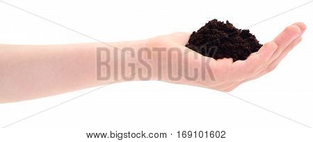Soil in hand isolated on white background.