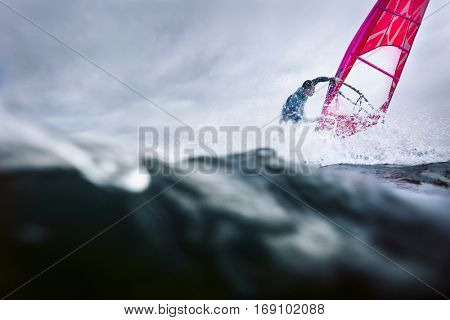 professional surfer in the waves doing tricks and stunts