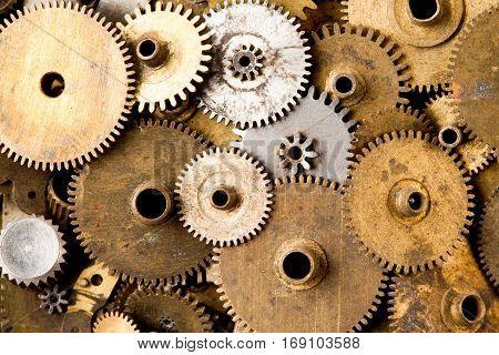 Vintage gears closeup. Aged mechanical clock wheels background. Shallow depth of field, soft focus