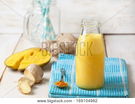 Detox drink. Smoothies with mango ginger turmeric in a glass bottle