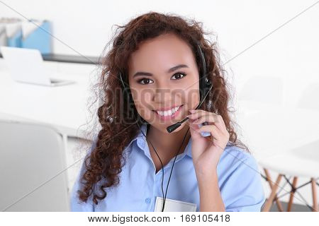 Young female technical support dispatcher working in office, closeup