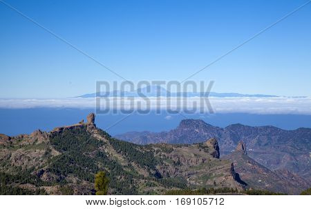 central Gran Canaria in January view from the highest point of the island Pico de Las Nieves across Caldera de Tejeda towards Teide on Tenerife. Both Roque Nublo and Roque Bentayga visible