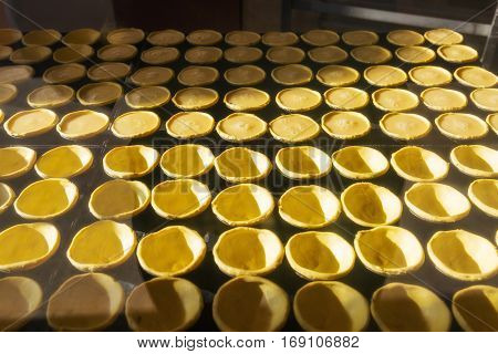 Tart for the Portuguese dessert Pastel de nata. Production of Pastel de nata