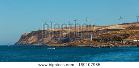 Cape Jervis Lighthouse And Windfarm Viewed From The Sea, South Australia.