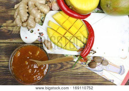 Bowl of homemade fresh Mango Chutney on old wooden table