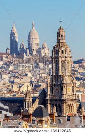 Sacre Coeur Basilica and the typical buildings of Paris.