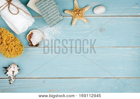 Spa resort concept on blue wooden background with copy space