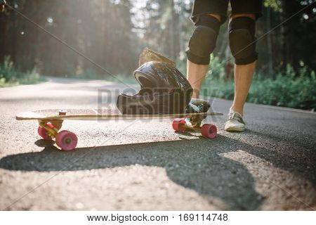 Longboard Man On Road At Beautiful Summer Morning In Nature